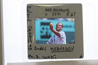 Slides photo of Andriy Medvedev playing a Tennis Olympic.