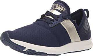 New Balance Women's Nergize V1 FuelCore Cross Trainer, Pigment/Metallic Gold, 7 B US
