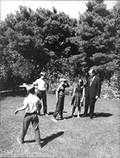 Vintage photo of Andreas G. Papandreou with children in garden.