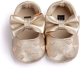 gold branded baby shoes