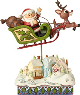 Enesco Rudolph The Red Nosed Reindeer by Jim Shore Sleigh Over Village Figurine, 7.2