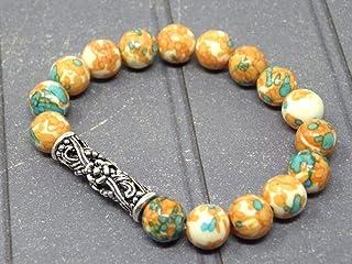 Bracciale da donna con perla centrale in filigrana tibetana e perle di giada tinte di arancione e blu
