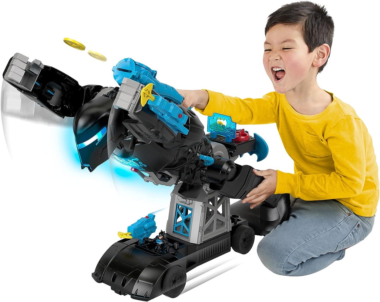 Imaginext DC Super Friends Transforming Bat-Tech Batbot - Boy in action with the transformed Bat-Tech Batbot