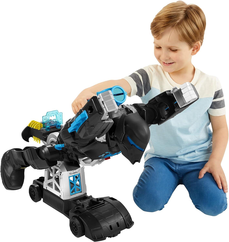 Imaginext DC Super Friends Transforming Bat-Tech Batbot - Boy with transformed robot Batbot