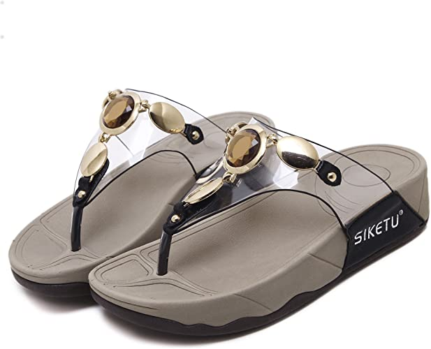 Une paire de sandales femme chaussons dans l'été Noir de l'UE37CN38