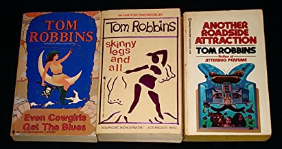 "3 Titles By Tom Robbins: ""Even Cowgirls Get the Blues,"" ""Skinny Legs and All,"" ""Another Roadside Attraction."""