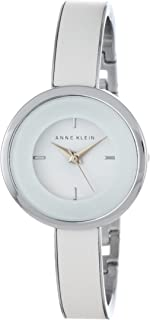 Anne Klein Women's AK/1233WTSV Silver-Tone Bangle Watch with White Leather Insert