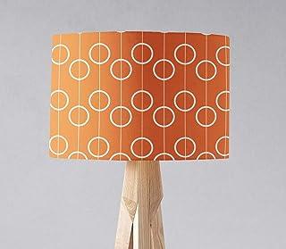 Una pantalla de lámpara naranja con diseño retro de círculo blanco, una lámpara de mesa o una lámpara de techo.
