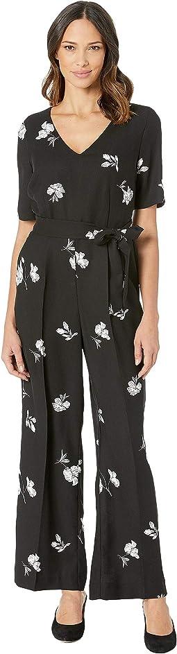 f14b1de28a11 Bcbgeneration low v striped jumpsuit black cashmere combo