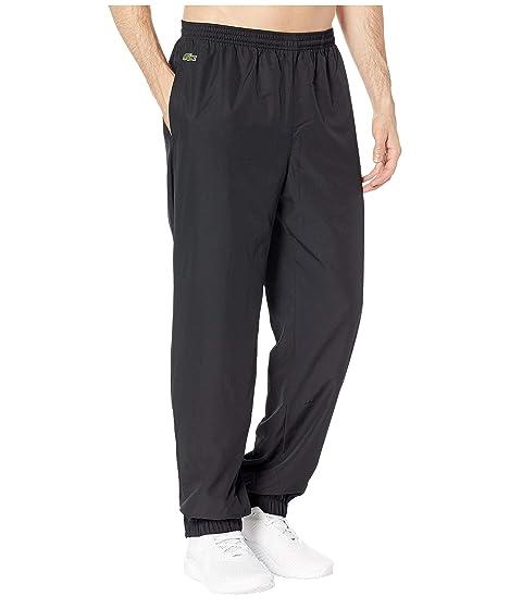 70b5d549be76 Lacoste Sport Taffeta Pants w  Side Zip Detail at Zappos.com