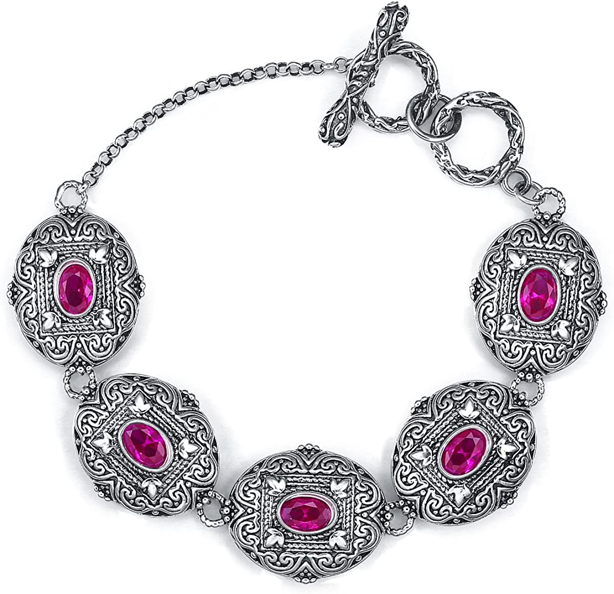 Sterling Silver bracelet with Ruby charms