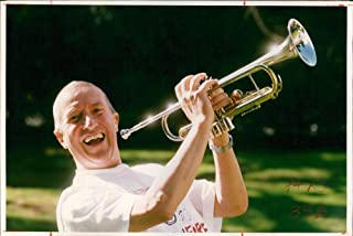Vintage photo of Roy Castle, former English entertainer play trumpet