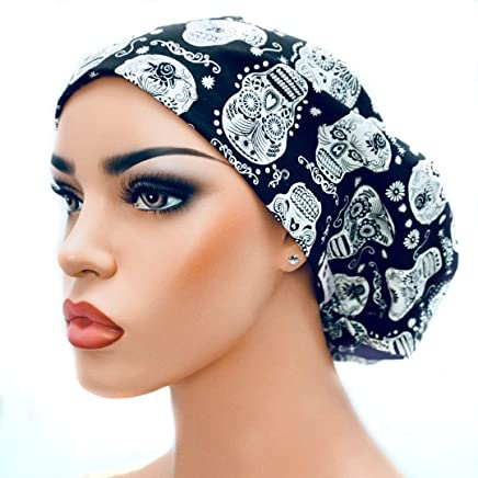04dc0107b9e DK Scrub Hats Womens Adjustable Bouffant Surgical Ponytail Cap Black with  Glow in the Dark Skulls