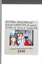 Slides photo of Woody Harrelson, Michael J. Fox and Julie Warner in Doc Hollywood.
