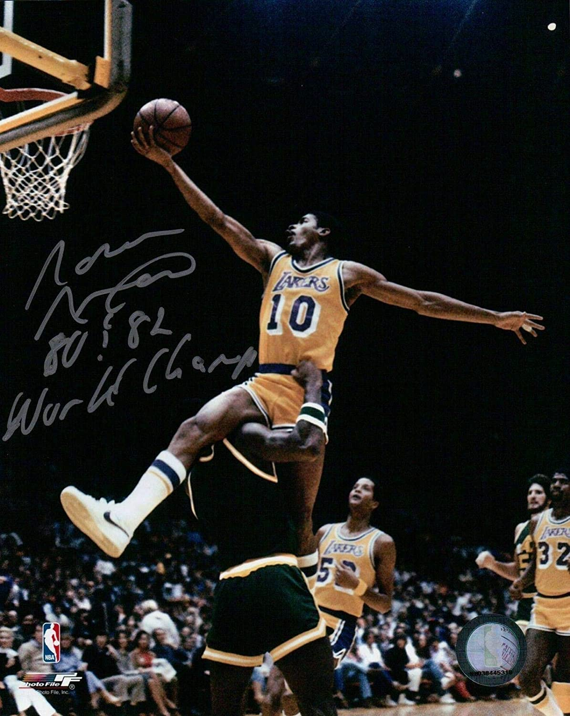 Autographed Norm Nixon Photograph  with 80 & 82 World Champ Inscription  Autographed NBA Photos