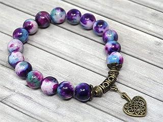 Bracciale chic per donna Thurcolas in perle di giada colorate blu e viola con nappa in bronzo antico a forma di cuore in f...