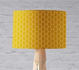 Pantalla de lámpara amarilla con diseño geométrico de cuadrados blancos, lámpara de sobremesa o plafón.