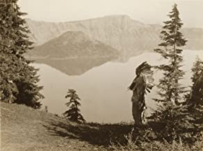 Klamath Indian chief in ceremonial headdress standing on hill overlooking lake California or Oregon Poster Print (18 x 24)