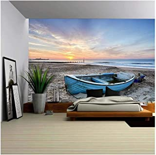 wall26 - Turquoise Blue Fishing Boat at Sunrise on Bournemouth Beach with Pier in Far Distance - Removable Wall Mural | Self-Adhesive Large Wallpaper - 100x144 inches