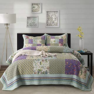purple and green patchwork quilt