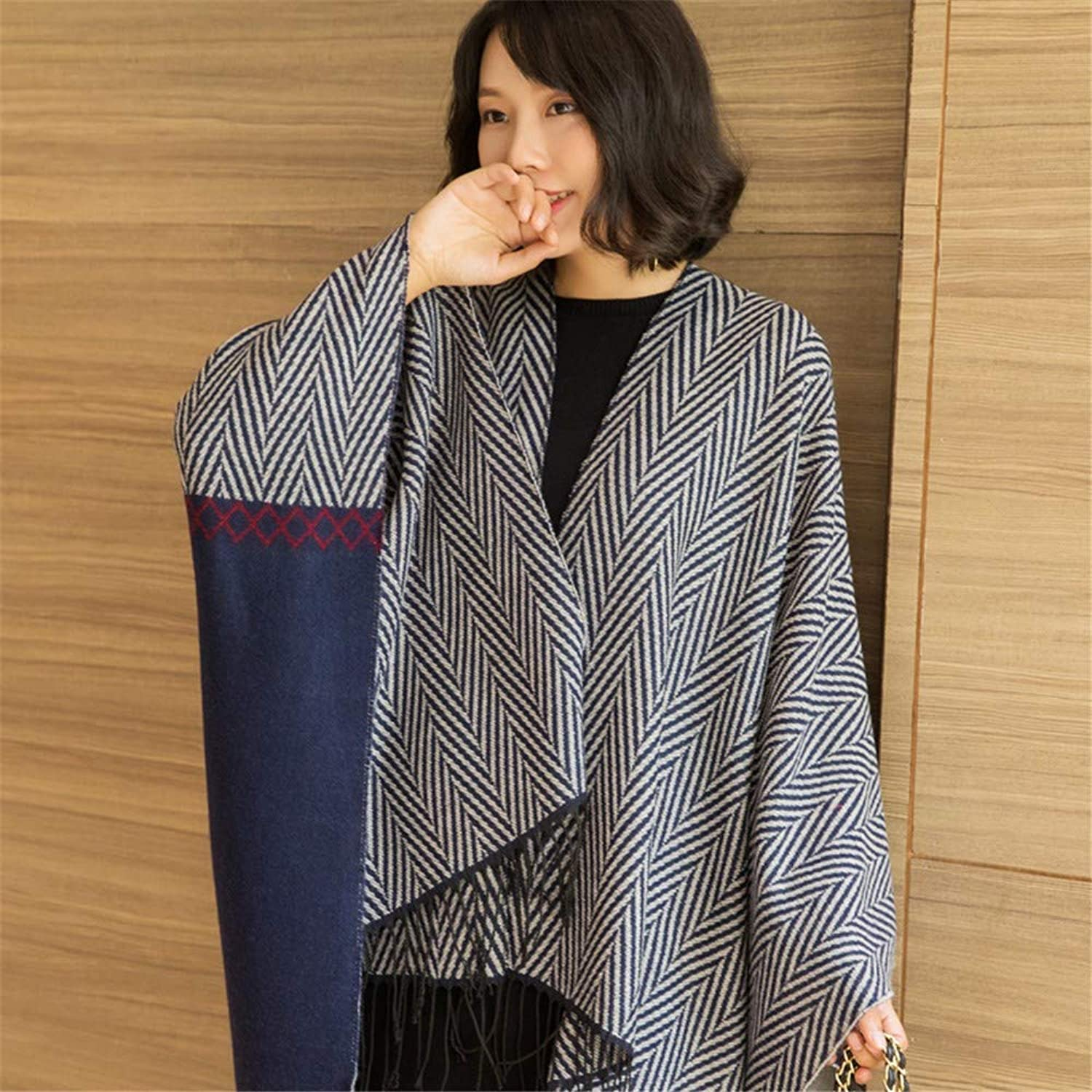 A Long Shawl Scarf and a Thickened Cape Coat.