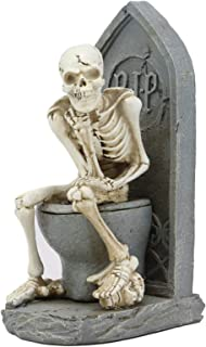 skeleton on toilet
