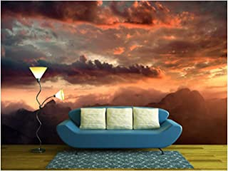wall26 - Fiery sunset over the mountain peaks with dramatic cloud formation - Removable Wall Mural | Self-adhesive Large Wallpaper - 100x144 inches
