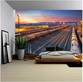 wall26 - Cargo Freigt Train Railroad Station at Dusk - Removable Wall Mural   Self-Adhesive Large Wallpaper - 100x144 inches