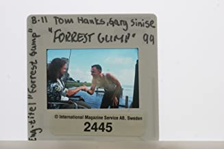 Slides photo of Gary Senise as Lieutenant Dan Taylor and Tom Hanks as Forrest Gump in the movie