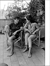 Vintage photo of Marina Vlady with her second husband Jean-Claude Brouillet in her home.