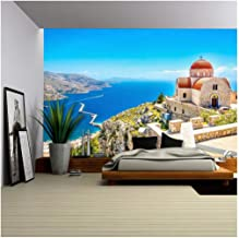 wall26 - Amazing View on Remote Church with Red Roofing on The Cliff of The Sea, Greece - Removable Wall Mural   Self-Adhesive Large Wallpaper - 100x144 inches