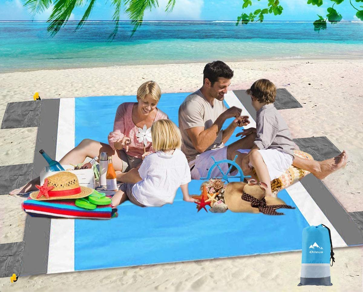Oileus Beach Blanket 79x83 Picnic Blankets Waterproof Sand Proof for 4-6 Adults Oversized Lightweight Beach Mat with 4 Stakes,6 Sand Pocket Portable Travel Camping Hiking Packable Bag