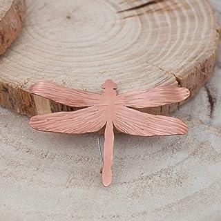 Broche libélula para mujer en color rosado y textura martillada.