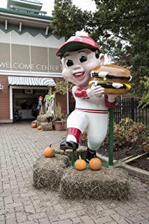 Photograph - Statue of a Frisch's Big Boy hamburger-chain mascot, dressed in a Cincinnati Reds' baseball team uniform, stands at the Cincinnati Zoo and Botanical Garden 44in x 66in