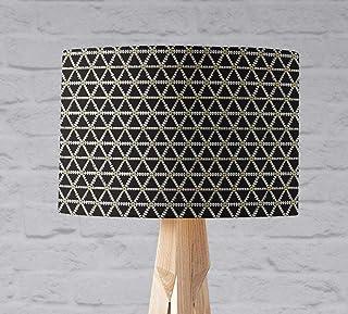 Pantalla negra con un triángulo geométrico blanco y dorado, de sobremesa o plafón.
