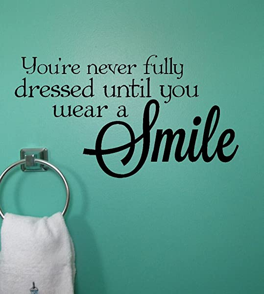 Wall Decor Plus More WDPM3183 Never Dressed Wear A Smile Wall Decal Inspirational Quote 23x12 5 Inch Black