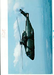 Vintage photo of There is speculation that the governmaent is about 20-25 along with 8-10 of the boeing chinook twin rotor helicopter.