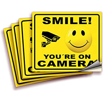 Smile You're On Camera Signs Stickers – 4 Pack 7x6 Inch – Premium Front Adhesive Vinyl Stickers, UV, Weather, Scratch, Water and Fade Resistance, for applying Inside The Window or Glass Door.