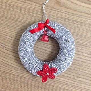 Ghirlanda natalizia in argento con stella di natale fatta a mano all'uncinetto