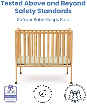 Delta Children Folding Portable Mini Baby Crib with 1.5-inch Mattress, Natural
