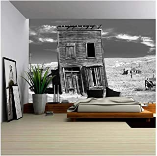 wall26 - Old Building Propped Up by a Wooden Post in an Old West Ghost Town. - Removable Wall Mural | Self-Adhesive Large Wallpaper - 100x144 inches