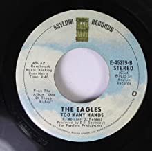 THE EAGLES 45 RPM LYIN' EYES / TOO MANY HANDS