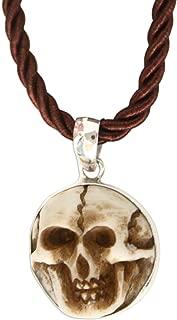 NOVICA Artisan Hand Carved Cow Bone Skull Pendant Necklace on Silk Cord, Aged Immortal Smile', 17