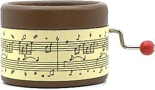 Caja de música marrón decorada con escritura musical y la melodía El lago de los cisnes