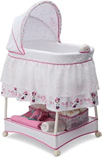 Delta Children Gliding Bedside Bassinet - Portable Crib with Lights, Sounds and Vibration, Disney Minnie Mouse Boutique