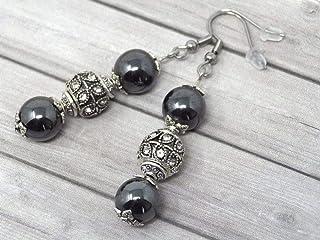 Orecchini in acciaio con perle nere ematite, e perline con cristalli