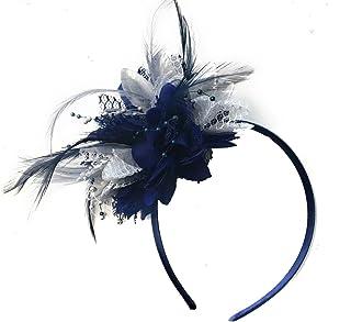 Tocado con ramillete azul marino y plateado en diadema para bodas