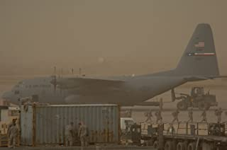Home Comforts Typical Airfield Operations Continue Despite a dust Storm at Sather Air Base, Iraq, on Jan. 30. Sath Vivid Imagery Laminated Poster Print 24 x 36