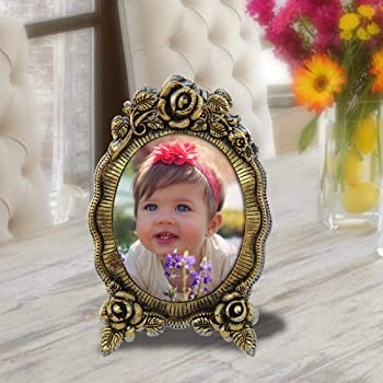 Handicrafts Paradise Antique Floral Motif Oval Shaped Aluminium Metal Photo Frame (13.3 cm x 1.2 cm x 20.4 cm)