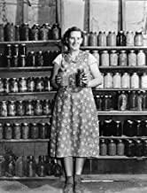 Colorado Housewife 1939 Nmrs Alfred Peterson Wife Of Tenant Purchaser Borrower With Jars Of Preserved Food In Mesa County Colorado Photograph By Arthur Rothstein 1939 Poster Print by (24 x 36)
